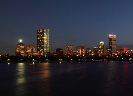 Night photography image of Boston sklyline and Charles River